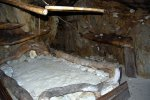 50_Bed_inside_one_of_the_cave_cottages_(New_Sea_Roc-Nosy_Hara)